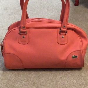 Lacoste purse....unusual bag, hard to find!